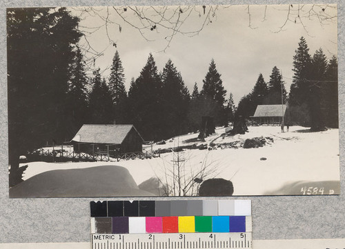 Whitaker's Forest 4-H Camp in April, 1929 with the commissary at the left and headquarters building at the right. View from the boys' camp. Metcalf. May, 1929