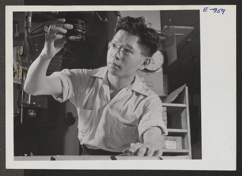 "Richard Sakamoto and his wife came to Washington from the Granada Relocation Center. He is now working for a photographic studio. Photographer: Parker, Tom ""Washington, D.C."""