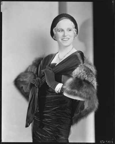 Peggy Hamilton modeling a [velveteen?] dress, fur stole and hat, 1931