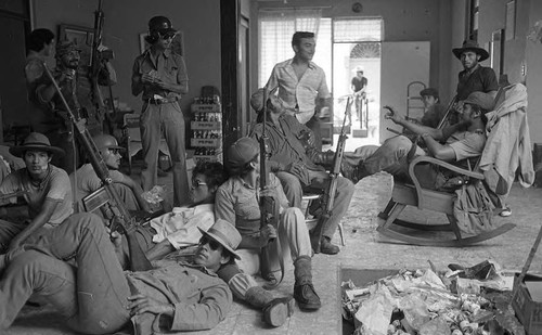 Sandinistas chatting and relaxing in a room, Leon, 1979