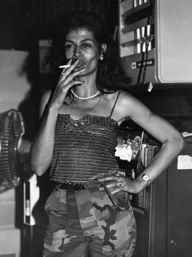 Maria smoking at the Grand Prix Club