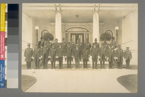 [Group portrait of police officers. Unidentified location. Photograph by Max W. Greene.]