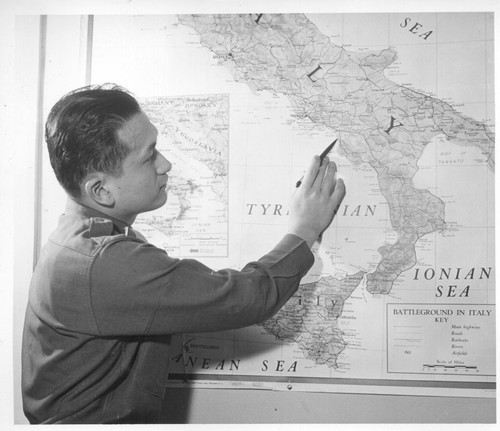 1st Lt. Shigeru Tsubota points out where he was serving in Italy with the 100th Battalion. Lt. Tsubota is a