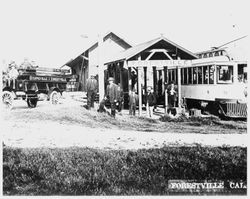 Russell's Auto Stage is parked in front of the Forestville P&SR railroad depot, about 1910