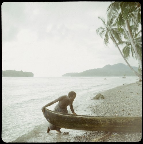 Man with boat at beach