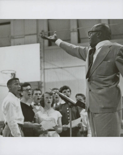 Jester Harrison, choral conductor, leads a group of singers, Petaluma, California, November 12, 1954