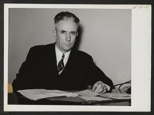 John H. Putz is the Relocation Officer for the State of Wisconsin with headquarters in Milwaukee. Photographer: Mace, Charles E. Milwaukee, Wisconsin