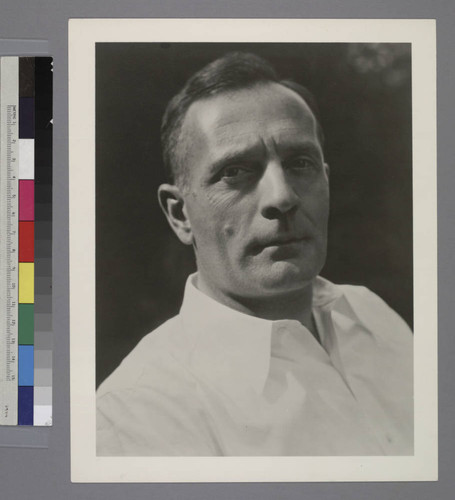 Portrait of Edwin Powell Hubble in a white collared shirt