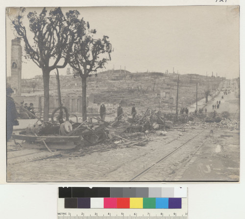 [Row of burned cable cars. California St., looking east toward Nob Hill.]