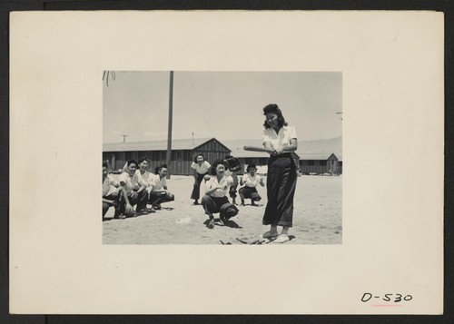 Manzanar, Calif.--Maye Noma behind the plate and Tomi Nagao at bat in a practice game between members of the Chick-a-dee