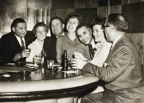 Jack and Mary Dei seated at a bar with others in Tijuana, Mexico, November 15, 1962