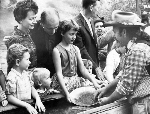 Mr. and Mrs. Robert Schuster and daughters learn how to pan for gold