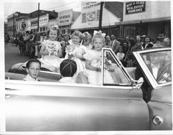 Sebastopol Apple Blossom Princesses in a car driven by Stan Janes of Stans Men's Store, about 1951