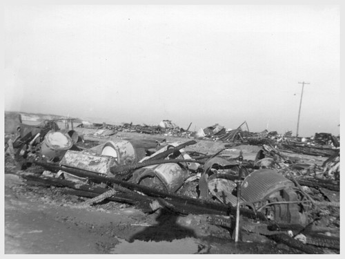 46 electric washing machines were destroyed in a Christmas night 1943 blaze in Block 202, Poston Unit II. Two mangles, 29 gas stoves, 8 electric refrigerators and an electric stove also were destroyed. The buildings served as warehouses for evacuee and personnel household goods.--Poston, Arizona. 12/25/43