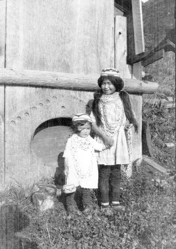Requa: Small children in front of the doorway of the Brooks' house