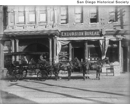 Horse-drawn coach in front of the San Diego Excursion Bureau