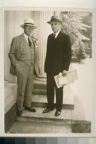 Noted Hearst writer at White House. Wash., D.C.... Arthur Brisbane (left), distinguished writer for the Hearst newspapers, and James T. Williams, Jr., editorial writer, leave the White House after seeing president Hoover. [Reporters covering Thomas Mooney case?] [1932]