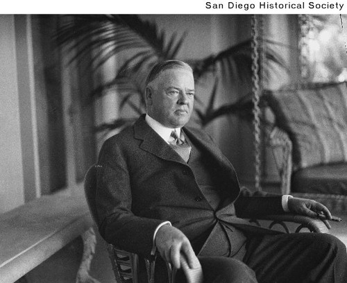 President Herbert Hoover seated in a chair