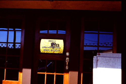 Door of Polley Polley & Madsen Real Estate business, 1977