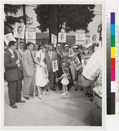 Edmund G. Brown speaking to a little girl at a campaign rally