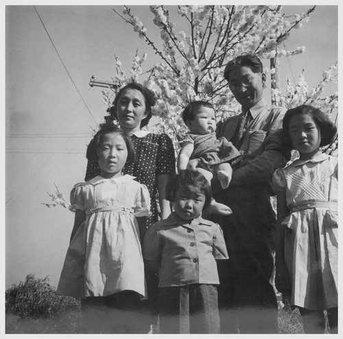 Henry Mitarai, age 36, successful large-scale farm operator with his family on their ranch about six weeks before evacuation. This family, along with other families of Japanese ancestry, will spend the duration at War Relocation Authority centers. Photographer: Lange, Dorothea Mountain View, California