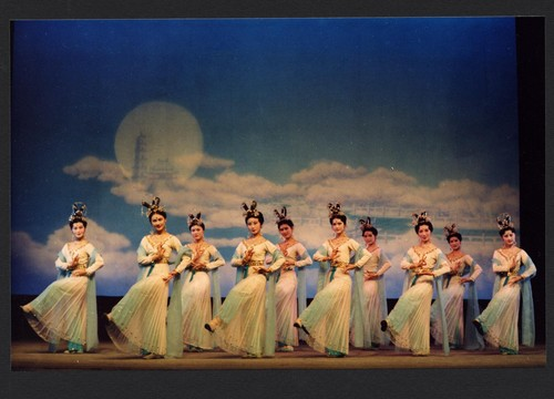 10 Chinese women dancing before dream scenery with clouds, moon, pagoda and tower /