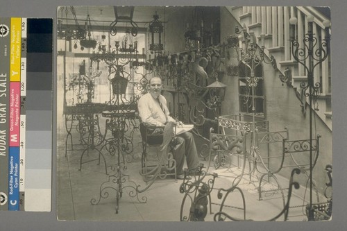 [Unidentified man. Interior of store. Liberty Ornamental Iron & Wire Works Inc.?]
