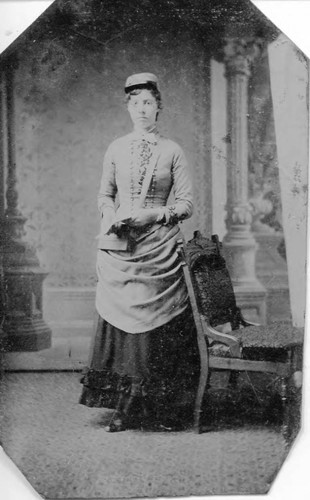 Unidentified young woman (possibly friend or family member of Otis Allen family) in Victorian dress, circa 1870