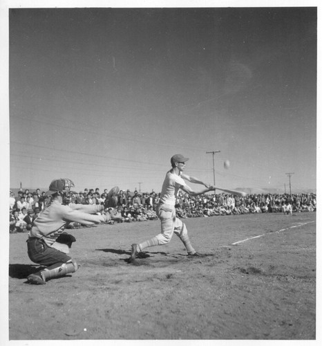 The 1944 league baseball season got under way at the Tule Lake Segregation Center on April 19. Project Director Ray R. Best tossed out the first ball. Nearly half of the 17,000 residents of the center were present for the opening game. Newell, California