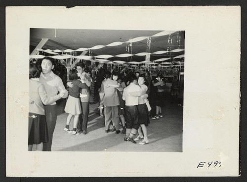 A regular Saturday evening dance at Terry Hall, a mess hall in the school block which has been used for social functions and adult class groups. Photographer: Parker, Tom Amache, Colorado