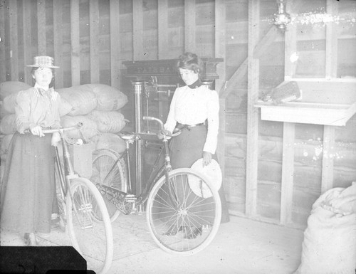 [Women with bicycles]