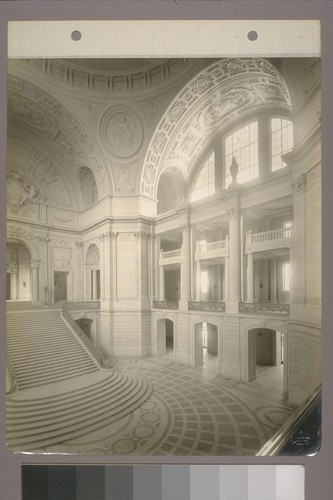 [Rotunda, grand staircase, galleries, and arched windows.]