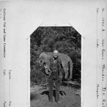 "Photographs from Wild Legacy Book. ""Game Warden D.E. Roberts"" with a mountain lion over his shoulders"