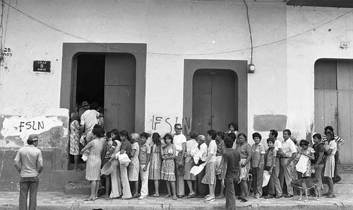 People line up outside of a building, Leon, 1979