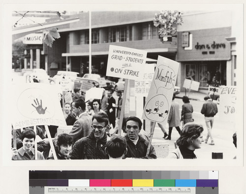 View of pickets with signs on Bancroft Way at Telegraph Avenue