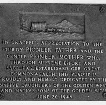 Close-up view of the bronze plaque located on the west entrance of the California State Capitol building donated by the Native Daughters and Sons of the Golden West