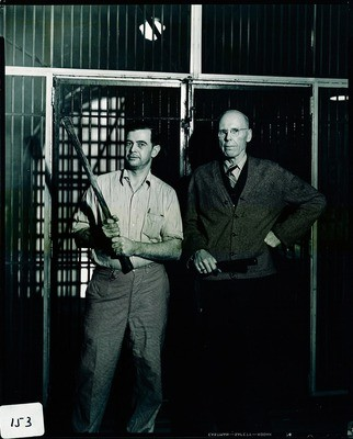 Stockton - Jails: Jailers, Bob Patton and another standing in front of closed cells with billy clubs in hand