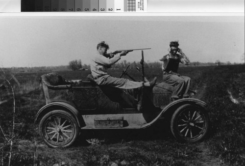 Photograph of two hunters on Model T at the Sunny Bank Farm in Nicolaus (Calif.)