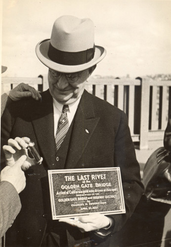 The last symbolic rivet of the Golden Gate Bridge, presented by Charles H. Segerstrom to Joseph Strauss, April 27, 1937 [photograph]
