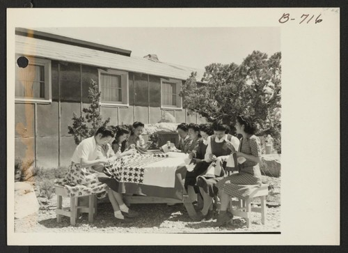 The sewing class teachers at Topaz making the Service Flag. Photographer: Bankson, Russell A. Topaz, Utah