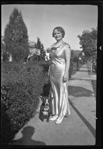 Ruth Davis, candidate for ordination, Spiritual Psychic Science Church, and  dog, 1936 — Calisphere