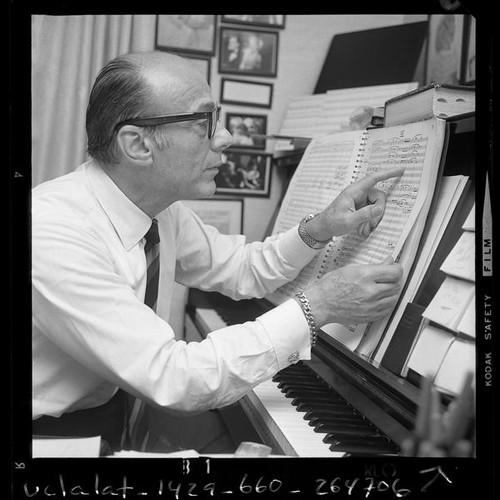 Calisphere Conductor John Green Seated At Piano Examining