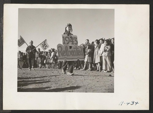 Two of the participants of the Harvest Festival parade, which was witnessed by a large crowd of the residents at this relocation center. Photographer: Stewart, Francis Newell, California