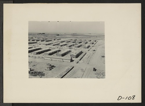 Eden, Idaho--A panorama view of the Minidoka War Relocation Authority center. This view, taken from the top of the water tower at the east end of the center, shows partially completed barracks. Photographer: Stewart, Francis Hunt, Idaho