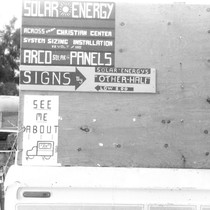 Slab City: photograph of signs advertising solar panel sales booth