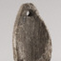 Chumash incised steatite comal / pendant