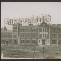"[Factory buildings with ""Ghirardelli"" sign across rooftops. South facade.]"