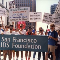 People marching with San Francisco AIDS Foundation banner and Stop LaRouche signs