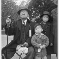 Hayward, Calif.--Grandfather and grandchildren awaiting evacuation bus. The grandfather conducted a dyeing ...