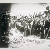 Longshoremen burning pink books (or blue books?) after winning short strike against ...